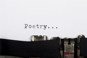 word `poetry `printed on paper