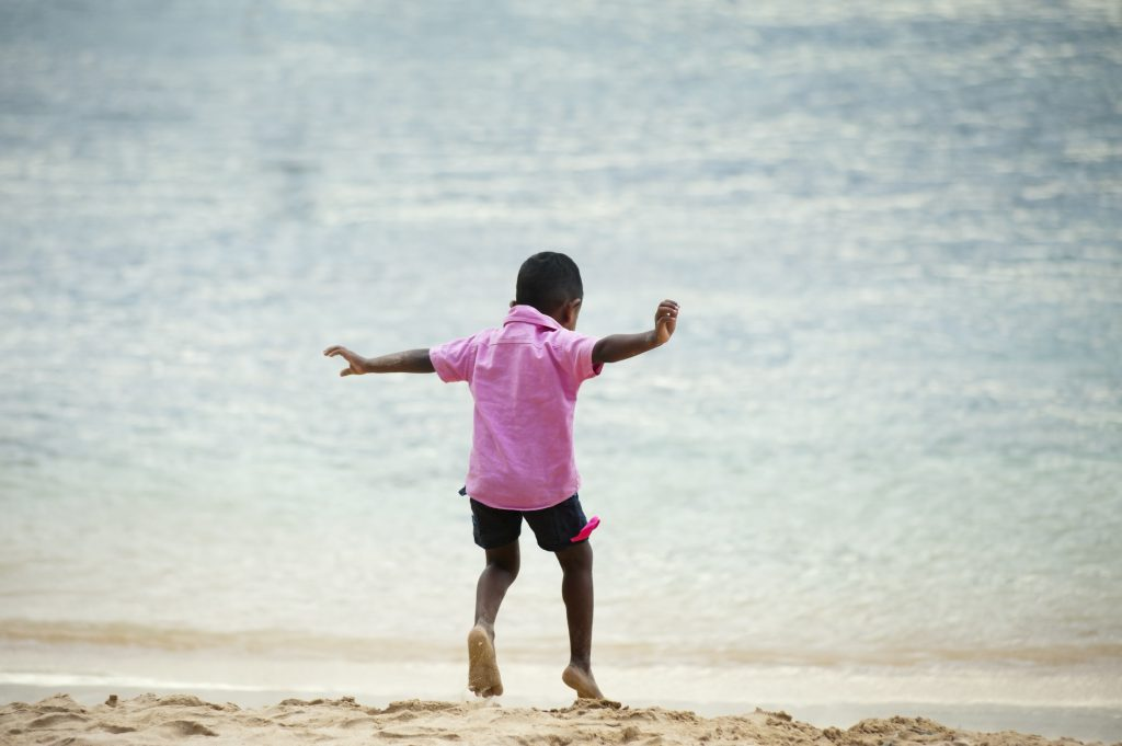 boy-playing-on-the-beach