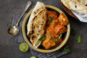 Butter chicken served with Naan Bread
