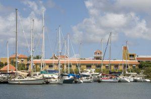 Sail boats docked together at a marina in Bonaire, Caribbean.