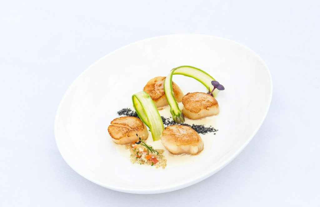 Pan seared Boston Bay scallop voloute, squid ink crumble, asparagus, quinoa