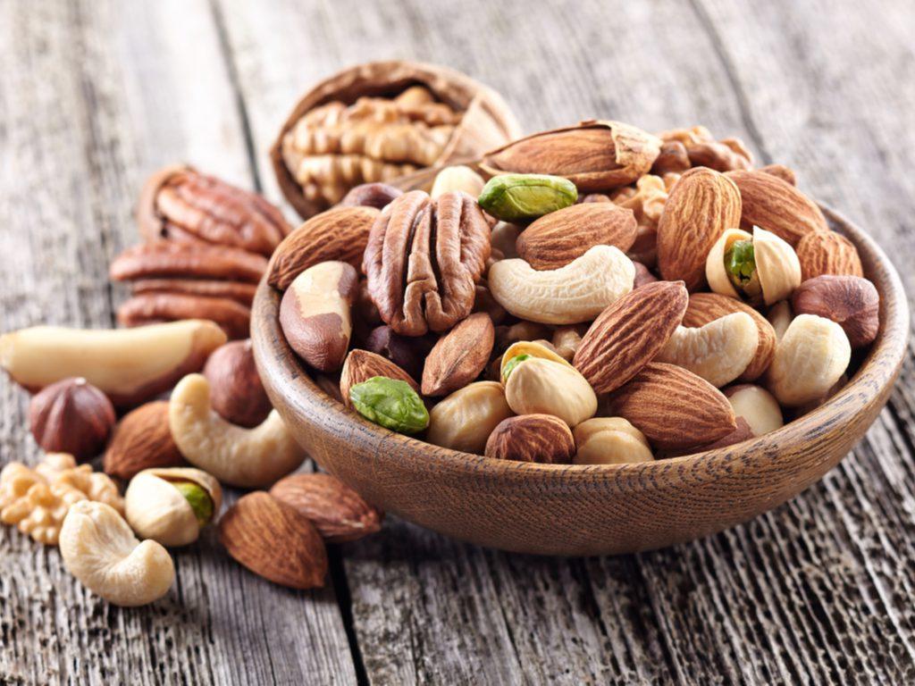 A bowl of pecans, cashews, almonds, hazelnuts, and pistachios.