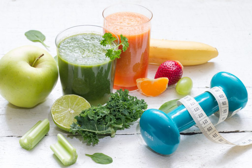 Fruits, vegetables, juice, smoothie and dumbbell health diet fitness concept