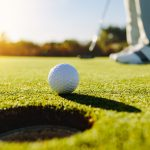 Professional golfer putting ball