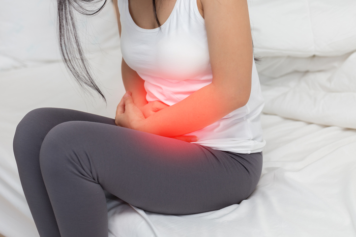 stomachache in young Asian woman