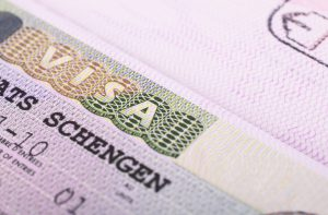 Close up of Schengen visa in passport.
