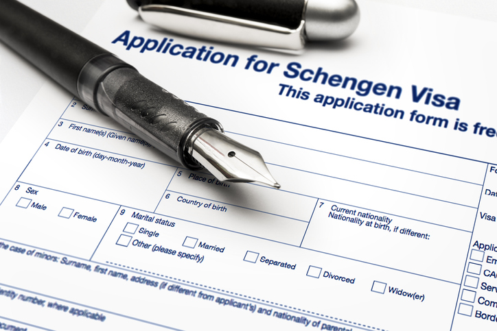 close up from a Application for Schengen visa and passport