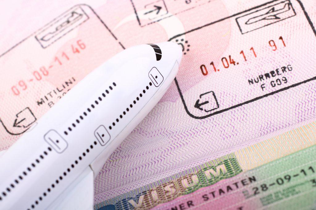 Passport with Schengen visa and stamps from Schengen countries.