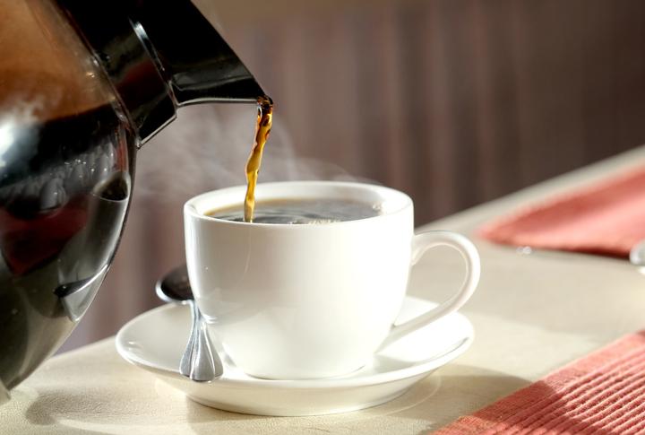 Black coffee poured into white mug.
