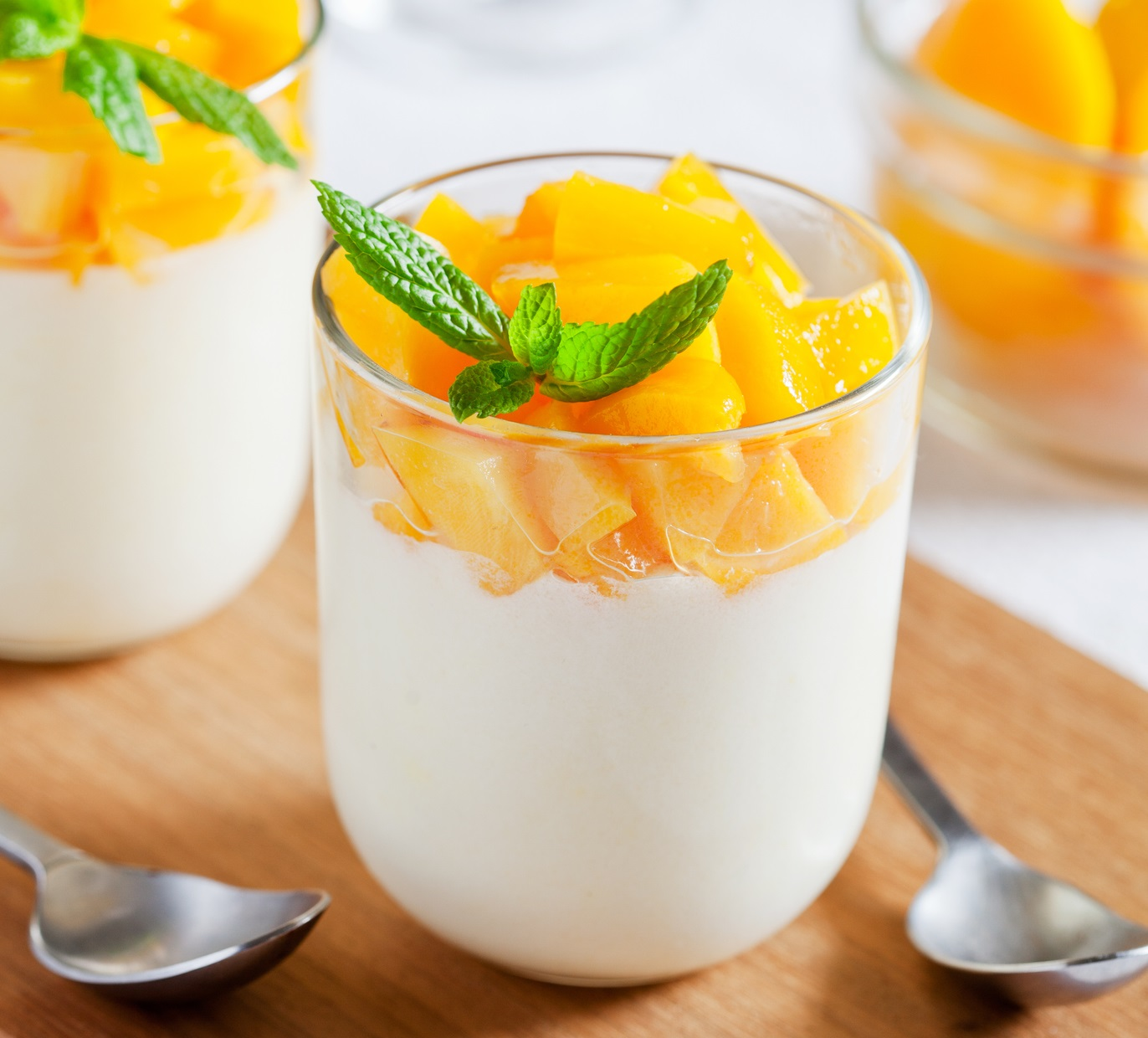 Yogurt topped with mangoes.