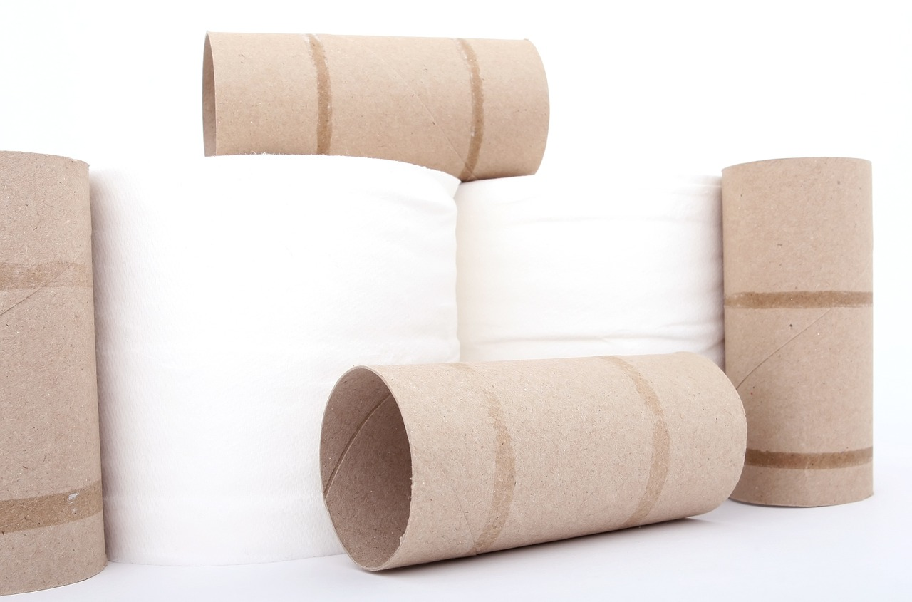 Toilet paper rolls on white background. Buying toilet paper in bulk is a good way to save money at the supermarket.