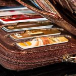 Various credit cards in brown leather wallet.