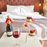 Hotel room with champagne and dessert