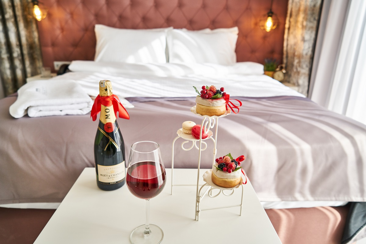 Hotel room with champagne and desserts.