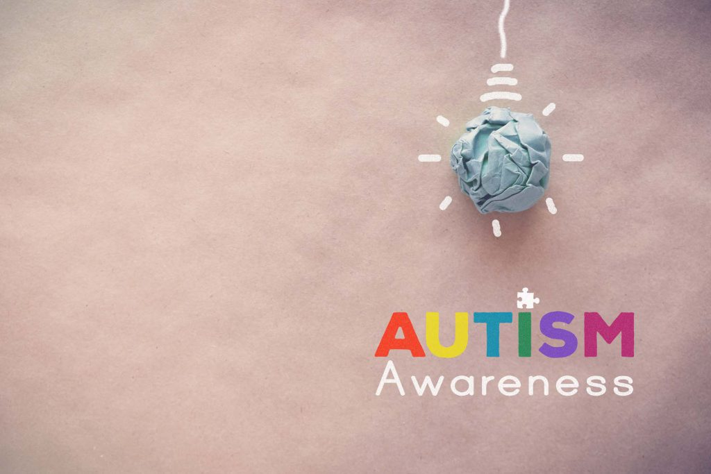 Blue paper light bulb , world Autism awareness day